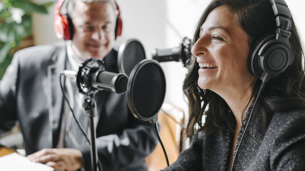 man and woman podcasting and transcribing